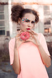 Beauty fashion model girl taking colorful donuts. Funny joyful woman with sweets, dessert. Diet, dieting concept. Junk food, Slimm Royalty Free Stock Photography