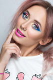 Beauty fashion model girl with two pink ponytail hairstyle. stock photo