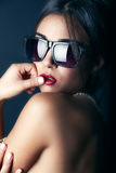 Beauty Fashion model girl wearing stylish sunglasses Stock Photos