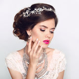 Beauty Fashion Model Girl with wedding elegant hairstyle. Beautiful bride woman with precious jewels, manicured nails. Makeup. royalty free stock images
