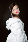 Beauty Fashion Model Girl in white mink Fur Coat. Beautiful Luxu Royalty Free Stock Images