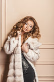 Beauty Fashion Model Girl in White Mink Fur Coat. Beautiful Luxury Winter Woman Stock Photo