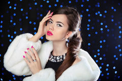 Beauty Fashion Model Girl in white mink Fur Coat. Makeup. Beauti Stock Image