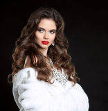 Beauty Fashion Model Girl in white Mink Fur Coat. Red lips makeu Royalty Free Stock Image