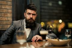 Beauty Fashion model . Fashion look. Concept photo of rich people luxury life. Adult successful elegant businessman. Wearing suit and drinking wine in luxury Stock Photos