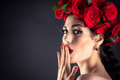 Beauty fashion model with red roses Royalty Free Stock Image