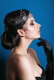 Beauty fashion model retro girl over blue background. Vintage style Woman Portrait. Luxury Lady. Vintage Style Lady with Beautiful Luxury Hairstyle, makeup royalty free stock images