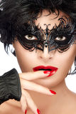 Beauty Fashion Model Woman Face in Black Masquerade Eye Makeup Royalty Free Stock Image