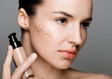 Beauty fashion model woman holding foundation tube Royalty Free Stock Images