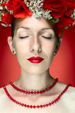 Beauty Fashion Model Woman with Red Poppy Flowers in her Hair Royalty Free Stock Image