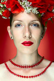 Beauty Fashion Model Woman with Red Poppy Flowers in her Hair Stock Photo