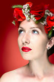 Beauty Fashion Model Woman with Red Poppy Flowers in her Hair Royalty Free Stock Photography