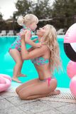 Beauty fashion mother with daughter family look. Beautiful blond royalty free stock photos
