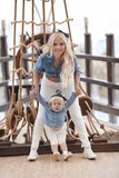 Beauty fashion mother with daughter family look. Beautiful blond Royalty Free Stock Images