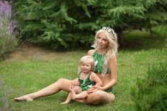 Beauty fashion mother with daughter family look. Beautiful blond stock photography