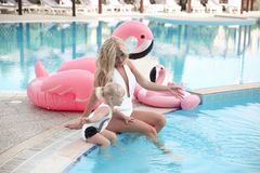 Beauty fashion mother with daughter family look. Beautiful blond. E pretty women having fun with adorable little girl wears in white swimwear having fun by stock photos