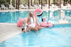 Beauty fashion mother with daughter family look. Beautiful blond. E pretty women having fun with adorable little girl wears in white swimwear having fun by stock image