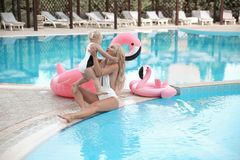 Beauty fashion mother with daughter family look. Beautiful blond. E pretty women having fun with adorable little girl wears in white swimwear having fun by stock photography