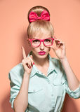 Beauty fashion nerdy woman thinking, glasses.Pinup Royalty Free Stock Images