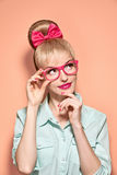 Beauty fashion nerdy woman thinking, glasses.Pinup Stock Photo