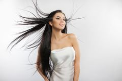 Beauty fashion photo of young beautiful girl in a flying white cloth. Royalty Free Stock Image