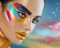 Beauty fashion portrait of beautiful woman with colorful abstract makeup Stock Photo