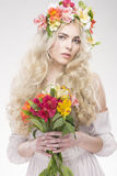 Beauty Fashion Portrait. Beautiful Woman with Curly Hair, Makeup. And Flowers Wreath Royalty Free Stock Image