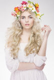 Beauty Fashion Portrait. Beautiful Woman with Curly Hair, Makeup. And Flowers Wreath Stock Photography