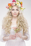 Beauty Fashion Portrait. Beautiful Woman with Curly Hair, Makeup. And Flowers Wreath Royalty Free Stock Photography