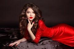 Beauty Fashion Portrait. Beautiful Woman with Curly Hair wearing Stock Image