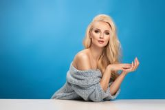 Beauty fashion portrait of woman on blue background royalty free stock photo