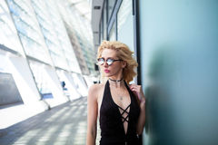 Beauty fashion portrait of blonde woman with pink lips. Fashion portrait of young elegant blonde woman outdoor. sunglasses, choker, black skirt and black top royalty free stock photo