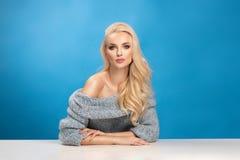 Beauty fashion portrait of woman on blue background stock image