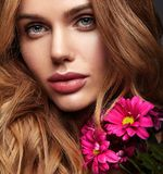 Young model with natural makeup and perfect skin. Beauty fashion portrait of young blond woman model with natural makeup and perfect skin with bright сrimson royalty free stock images