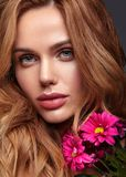 Young model with natural makeup and perfect skin. Beauty fashion portrait of young blond woman model with natural makeup and perfect skin with bright сrimson royalty free stock image