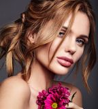 Young model with natural makeup and perfect skin. Beauty fashion portrait of young blond woman model with natural makeup and perfect skin with bright сrimson royalty free stock photo