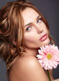 Young model with natural makeup and perfect skin. Beauty fashion portrait of young blond woman model with natural makeup and perfect skin with bright pink royalty free stock photography