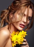 Young model with natural makeup and perfect skin. Beauty fashion portrait of young blond woman model with natural makeup and perfect skin with bright yellow royalty free stock photos