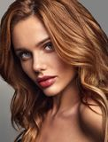 Young model with natural makeup and perfect skin. Beauty fashion portrait of young blond woman model with natural makeup and perfect skin posing in studio stock photos
