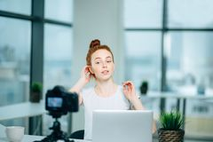 Beauty fashion redhead female blogger recording video stock image