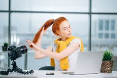 Beauty fashion redhead female blogger recording video royalty free stock photo