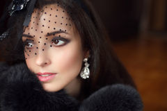 Beauty fashion retro woman wearing little hat with veil and luxu Royalty Free Stock Photo