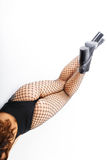 Beauty and fashion, shoes with high heels on sexy, female, slim, long legs in black fishnet tights, pantyhose or Royalty Free Stock Image