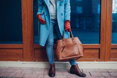 Beauty and fashion. Stylish fashionable woman wearing coat and gloves ,holding brown bag handbag stock photos