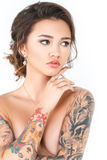 Beauty Fashion tattoo model with makeup and hair on a white background Royalty Free Stock Photo