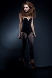 Beauty fashion woman body over black background Royalty Free Stock Photo