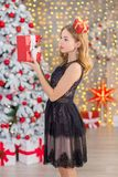 Beauty fashion woman Christmas background new year tree. Vogue style sexy girl. Gorgeous female in luxury dress at Xmas. Party. Luxury life concept. Retro style Stock Images