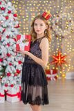 Beauty fashion woman Christmas background new year tree. Vogue style sexy girl. Gorgeous female in luxury dress at Xmas Royalty Free Stock Photography