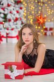 Beauty fashion woman Christmas background new year tree. Vogue style sexy girl. Gorgeous female in luxury dress at Xmas. Party. Luxury life concept. Retro style Royalty Free Stock Photography