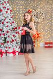 Beauty fashion woman Christmas background new year tree. Vogue style sexy girl. Gorgeous female in luxury dress at Xmas. Party. Luxury life concept. Retro style Stock Photography